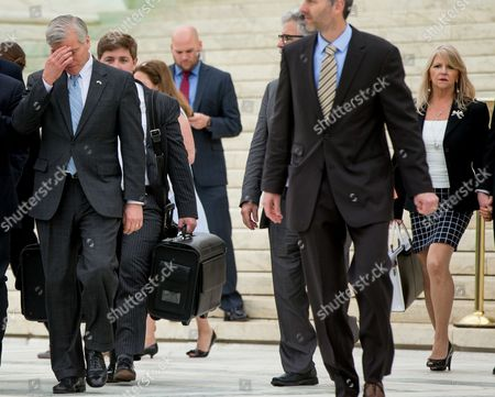Bob McDonnell, Maureen McDonnell Former Virginia Gov. Bob McDonnell, left, accompanied by his wife Maureen McDonnell, right, walks out of the Supreme Court in Washington, after the Supreme Court heard oral arguments on the corruption case of McDonnell. The Supreme Court seems likely to overturn the conviction of McDonnell on political corruption charges and place new limits on the reach of federal bribery laws