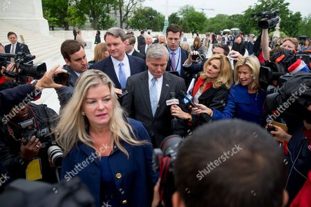 Bob McDonnell Former Virginia Gov. Bob McDonnell, center, is surrounded by members of the media as he leaves the Supreme Court in Washington, after the Supreme Court heard oral arguments on the corruption case against McDonnell. The Supreme Court seems likely to overturn the conviction of McDonnell on political corruption charges and place new limits on the reach of federal bribery laws