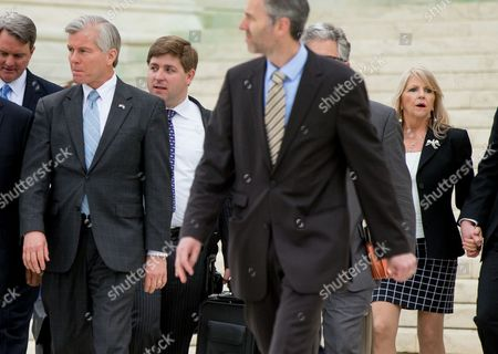 Bob McDonnell, Maureen McDonnell Former Virginia Gov. Bob McDonnell, second from left, accompanied by his wife Maureen McDonnell, right, walks out of the Supreme Court in Washington, after the Supreme Court heard oral arguments on the corruption case of McDonnell. The Supreme Court seems likely to overturn the conviction of McDonnell on political corruption charges and place new limits on the reach of federal bribery laws