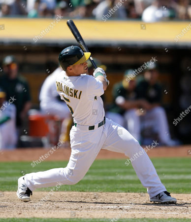 Jake Smolinski Oakland Athletics' Jake Smolinski swings for an RBI-sacrifice fly hit off Detroit Tigers' Mark Lowe in the eighth inning of a baseball game, in Oakland, Calif