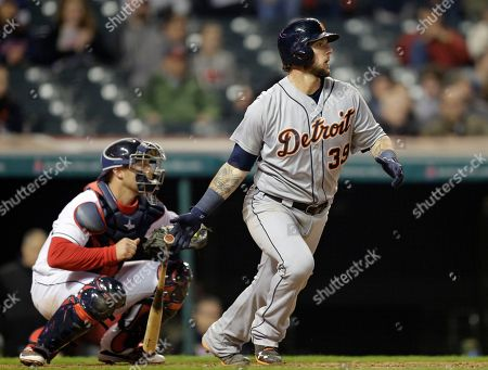 Chris Gimenez, Jarrod Saltalamacchia Detroit Tigers' Jarrod Saltalamacchia watches his ball after hitting an RBI-single off Cleveland Indians relief pitcher Joba Chamberlain in the ninth inning of a baseball game, in Cleveland. Nick Castellanos scored on the play. Indians catcher Chris Gimenez watches. The Indians won 9-4