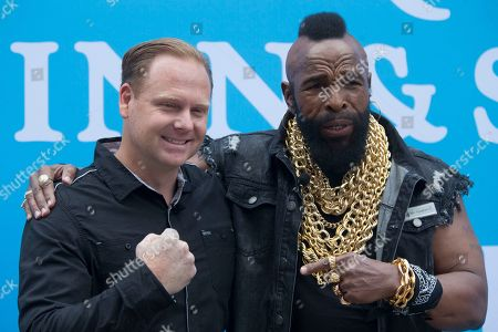 Mr. T, Nik Wallenda In honor of National Amazing Month Actor Mr. T, left, and High-Wire Artist Nik Wallenda pose for photographers after Wallenda walked a tight rope in midtown Manhattan, in New York