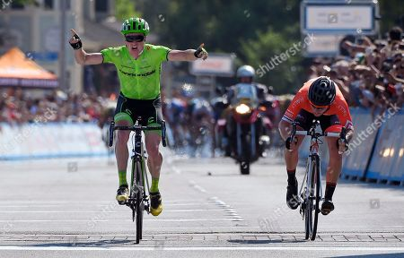 Benjamin King, Evan Huffman Benjamin King, left, celebrates as he wins Stage 2 ahead of Evan Huffman during the Amgen Tour of California cycling race, in Santa Clarita, Calif. King also became the overall leader