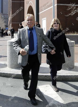 "Robert Fitzpatrick Robert Fitzpatrick, of Charlestown, R.I., walks from federal court in Boston with his wife Jane. Fitzpatrick, a former FBI agent accused of lying during his testimony in the trial of Boston gangster James ""Whitey"" Bulger, is expected to plead guilty to perjury charges. Fitzpatrick is scheduled to appear, in U.S. District Court in Boston for a change-of-plea hearing"