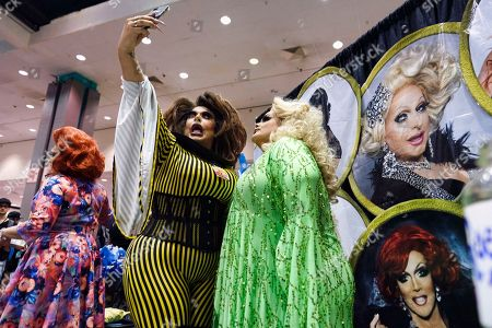 Stock Photo of Drag queen Darienne Lake, right, poses for a selfie with with a fan at RuPaul's DragCon, at the Los Angeles Convention Center in downtown Los Angeles