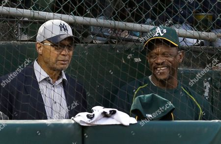 Reggie Jackson, Rickey Henderson Former New York Yankee Reggie Jackson, left, speaks with former Oakland Athletic Rickey Henderson during the third inning of a baseball game between the teams, in Oakland, Calif