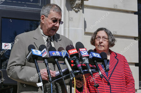Charles Ridulph, left, with Patricia Quinn, both siblings of Maria Ridulph, who was slain in 1957, speaks outside the DeKalb County courthouse following a court hearing, in Sycamore, Ill., in the case of Jack McCullough, who was convicted of Maria's murder. McCullough, who is serving a life sentence in Maria's slaying, has made an emotional statement declaring his innocence and pleaded with a judge to consider his bid for freedom. He cited a prosecutor's scathing review of the investigation that landed him in prison