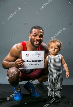 Jordan Burroughs, Beacon Burroughs US Olympic Gold medalist wrestler Jordan Burroughs with his son Beacon poses for photos at the 2016 Team USA Media Summit, in Beverly Hills, Calif