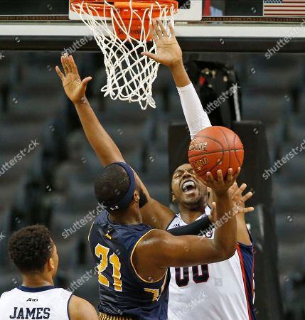 Darius Lewis, Jordan Price, Eric James Duquesne center Darius Lewis (00) defends as La Salle guard Jordan Price (21) goes up for a layup during the first half of an NCAA college basketball game in the Atlantic 10 men's tournament, in New York. Duquesne guard Eric James is at left