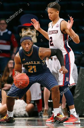 Jordan Price, Eric James La Salle guard Jordan Price (21) backs up into Duquesne guard Eric James (2) who avoids making contact during the second half of an NCAA college basketball game in the Atlantic 10 men's tournament, in New York. Price had 36 points as La Salle defeated Duquesne 88-73