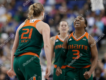 Michelle Woods, Jessica Thomas Miami's Jessica Thomas (3) and Michelle Woods (10), of the Netherlands, celebrate during the second half of an NCAA college basketball game against Florida State in the Atlantic Coast Conference tournament in Greensboro, N.C., . Miami won 74-56