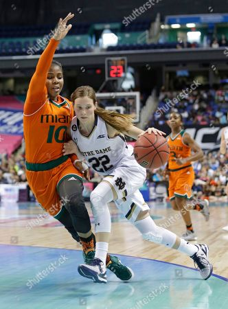 Madison Cable, Michelle Woods Notre Dame's Madison Cable (22) drives past Miami's Michelle Woods (10) during the second half of an NCAA college basketball game in the Atlantic Coast Conference tournament in Greensboro, N.C., . Notre Dame won 78-67