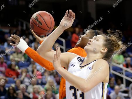 Michelle Woods, Kathryn Westbeld Miami's Michelle Woods, back, shoots as Notre Dame's Kathryn Westbeld, front, defends during the first half of an NCAA college basketball game in the Atlantic Coast Conference tournament in Greensboro, N.C