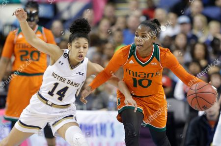 Michelle Woods, Mychal Johnson Miami's Michelle Woods (10) and Notre Dame's Mychal Johnson (14) chase a loose ball during the second half of an NCAA college basketball game in the Atlantic Coast Conference tournament in Greensboro, N.C., . Notre Dame won 78-67