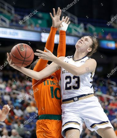 Michaela Mabrey, Michelle Woods Notre Dame's Michaela Mabrey (23) is fouled by Miami's Michelle Woods (10) during the second half of an NCAA college basketball game in the Atlantic Coast Conference tournament in Greensboro, N.C., . Notre Dame won 78-67