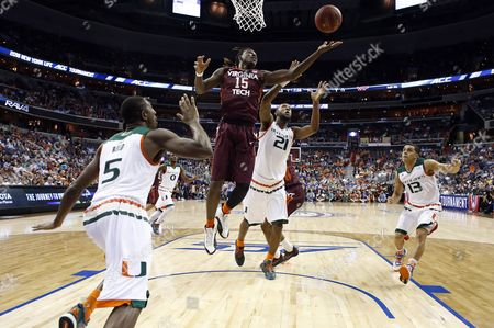 Davon Reed, Chris Clarke, Kamari Murphy Miami guard Davon Reed (5), Virginia Tech guard Chris Clarke (15) and Miami forward Kamari Murphy (21) look for a rebound during the first half of an NCAA college basketball game in the Atlantic Coast Conference men's tournament, in Washington