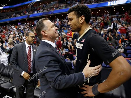Mark Gottfried, Devin Thomas North Carolina State head coach Mark Gottfried, left, talks with Wake Forest forward Devin Thomas (2) after an NCAA college basketball game in the Atlantic Coast Conference tournament, in Washington. NC State won 75-72