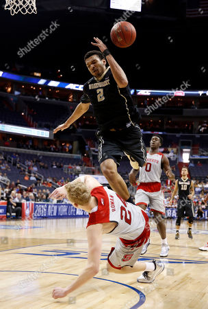Devin Thomas, Maverick Rowan Wake Forest forward Devin Thomas (2) falls over North Carolina State guard Maverick Rowan (24) during the second half of an NCAA college basketball game in the Atlantic Coast Conference tournament, in Washington. NC State won 75-72