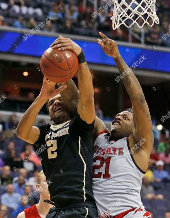 Stock Picture of Devin Thomas, BeeJay Anya Wake Forest forward Devin Thomas (2) and North Carolina State forward BeeJay Anya (21) battle for a rebound during the first half of an NCAA college basketball game in the Atlantic Coast Conference tournament, in Washington, D.C