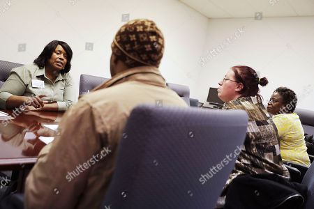 Stock Image of Sweet Tomatoes restaurant general manager Valerie Zimmerman, left, interviews Patricia Troutman, of Loganville, Ga., from right, Sabrina Britt, of Clarkston, Ga., and Nino Alexander, of Lithonia, Ga., for positions during a recruiting event at the Georgia Department of Labor office in Atlanta. On Wednesday, March 30, 2016, payroll processor ADP reports on how many jobs U.S. private companies added during March
