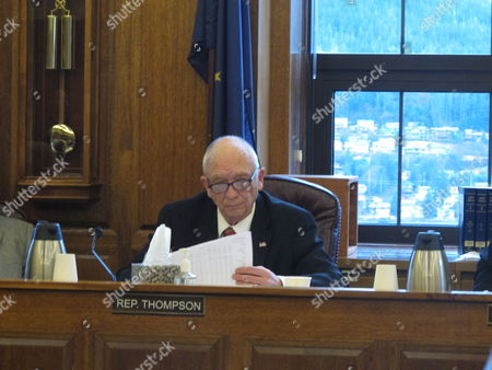 House Finance Committee co-chair Steve Thompson looks over documents during a meeting on the state operating budget, in Juneau, Alaska. The committee advanced its version of the budget Wednesday