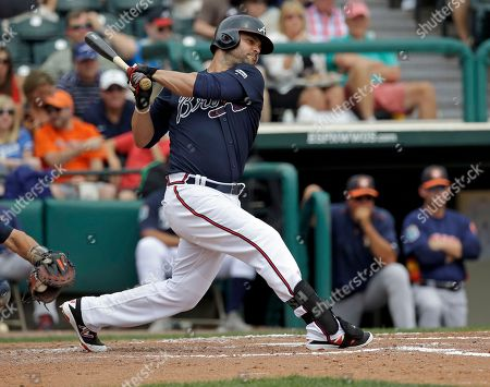 Atlanta Braves' Nick Swisher bats against the Houston Astros in a spring training baseball game, in Kissimmee, Fla