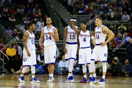 Frank Mason III, Perry Ellis, Carlton Bragg Jr., Devonte' Graham, Brannen Greene Kansas guard Frank Mason III (0), forward Perry Ellis (34), forward Carlton Bragg Jr. (15), guard Devonte' Graham (4) and guard Brannen Greene (14) during the first half of an NCAA college basketball game against Kansas State in the quarterfinals of the Big 12 conference tournament in Kansas City, Mo
