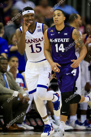 Carlton Bragg Jr., Justin Edwards Kansas forward Carlton Bragg Jr. (15) celebrates a three-point basket while covered by Kansas State guard Justin Edwards (14) during the second half of an NCAA college basketball game in the quarterfinals of the Big 12 conference tournament in Kansas City, Mo., . Kansas defeated Kansas State 85-63
