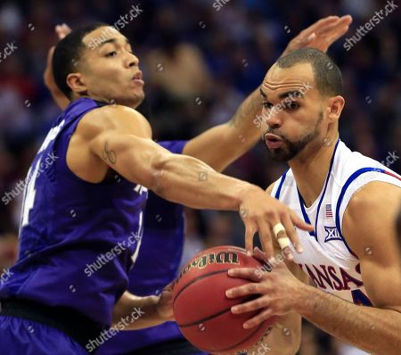 Perry Ellis, Justin Edwards Kansas forward Perry Ellis, right, drives past Kansas State guard Justin Edwards (14) during the first half of an NCAA college basketball game in the quarterfinals of the Big 12 conference tournament in Kansas City, Mo