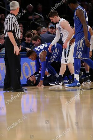 Jay Wright Seton Hall's Derrick Gordon (32) helps up Villanova head coach Jay Wright after knocking him down chasing a loose ball during the first half of an NCAA college basketball game during the Big East men's tournament, in New York. Seton Hall won 69-67