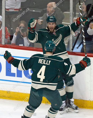Jarret Stoll, Mike Reilly Minnesota Wild's Mike Reilly, left, runs in to celebrate with Jarret Stoll after Stoll scored against Chicago Blackhawks goalie Scott Darling in the first period of an NHL hockey game, in St. Paul, Minn