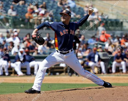 Stock Image of Houston Astros' Kevin Chapman pitches against the Atlanta Braves in the fifth inning of spring training baseball game, in Kissimmee, Fla