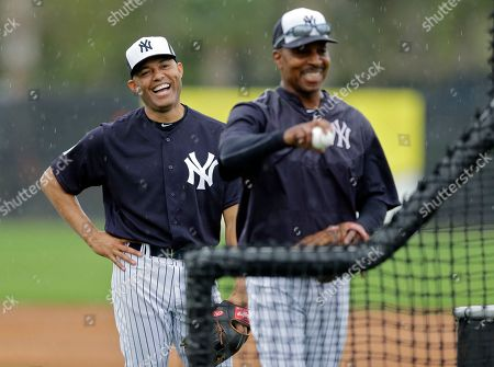 Mariano Rivera, Willie Randolph Former New York Yankees pitcher Mariano Rivera, left, laughs as he watches coach Willie Randolph throw batting practice before a spring training baseball game against the Atlanta Braves, in Tampa, Fla