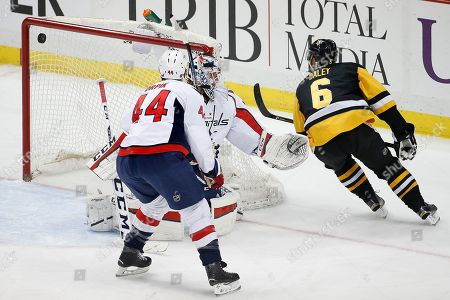 Trevor Daley, Braden Holtby, Brooks Orpik Pittsburgh Penguins' Trevor Daley (6) backhands a goal past Washington Capitals goalie Braden Holtby (70) with Brooks Orpik (44) defending during the first period of an NHL hockey game against the Washington Capitals in Pittsburgh