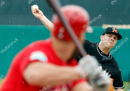 Stock Image of David Phelps, Matt Holliday Miami Marlins starting pitcher David Phelps delivers a ball to St. Louis Cardinals' Matt Holliday during the first inning of an exhibition spring training baseball game, in Jupiter, Fla