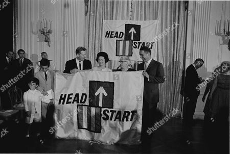 Ceremony for National Head Start Day in the Red Room of the White House, Washington, DC. June 30, 1965. In the front row L-R: Timothy Shriver, Robert Shriver, Danny Kaye, Lady Bird Johnson, Mrs. Lou Maginn (Director of a HeadStart project in East Fairfield, Vermont), and Sargent Shriver