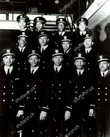 "In February 1944, the Navy commissioned its first African-American officers - The twelve commissioned officers, and a warrant officer who received his rank at the same time, came to be known as the ""Golden Thirteen,"" March 17, 1944 photo Top row: John Walter Reagan, Jesse Walter Arbor, Dalton Louis Baugh, Frank Ellis Sublett. Middle row: Graham Edward Martin, Charles Byrd Lear, Phillip George Barnes, Reginald E. Goodwin. Bottom row: James Edward Hair, Samuel Edward Barnes, George Clinton Cooper, William Sylvester White, Dennis Denmark Nelson."