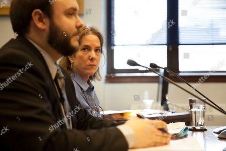 Daniel George, legislative staff member, and Legislative Finance Fiscal Analyst Kelly Cunningham testify during a hearing on a criminal justice system overhaul, in Juneau, Alaska