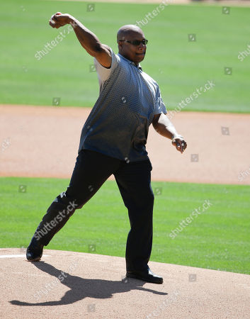 Former Chicago White Sox player Bo Jackson throws the ceremonial first pitch before a spring training baseball game between the Chicago White Sox and the Chicago Cubs, in Phoenix