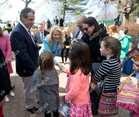 Stock Image of Andrew Cuomo,Sandra Lee New York Gov. Andrew Cuomo, left, and girlfriend Sandra Lee, center, greet guests at the Executive Mansion, in Albany, N.Y. Cuomo hosted an Easter egg hunt and open house at the mansion, the first of what the governor hopes will become an annual springtime tradition