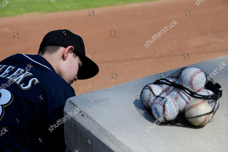 Ben Weber Ben Weber, 12, of Neenah, Wis., looks into the dugout while waiting to get baseballs signed a spring training baseball game between the Milwaukee Brewers and the Arizona Diamondbacks, in Phoenix