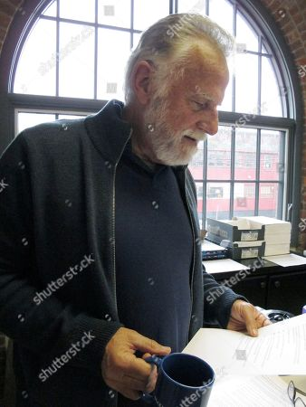 """Jonathan Goldsmith reads a script for a public service announcement, at the Make-A-Wish Vermont office in Burlington, Vt. Goldsmith, who appeared for nine years as the """"Most Interesting Man in the World,"""" in Dos Equis beer commercials, will star in public service announcements for Make-a-Wish Foundation Vermont. The Mexican beer brand recently dropped the 77-year-old for a younger replacement, who will appear in commercials later this year"""
