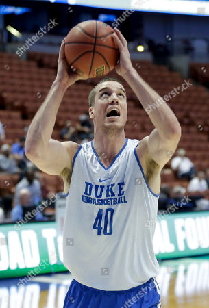 Duke's Marshall Plumlee takes a shot during college basketball practice in Anaheim, Calif., . Duke plays against Oregon in a regional semifinal game in the NCAA Tournament on Thursday