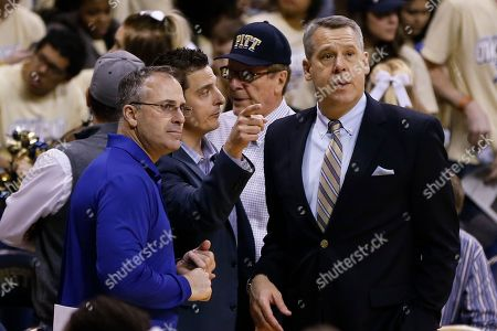 Scott Barnes, Pat Narduzzi University of Pittsburgh Athletic Director Scott Barnes, right, talks with football coach Pat Narduzzi, left, before an NCAA college basketball game between Pittsburgh and Duke, in Pittsburgh