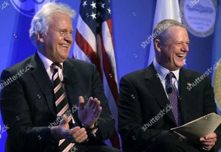 Jeff Immelt, Charlie Baker General Electric CEO Jeff Immelt, left, and Mass. Gov. Charlie Baker, right, smile during a news conference in Boston, held to unveil more details about GE's move to the city. GE is pledging to spend $50 million on a series of initiatives in Boston