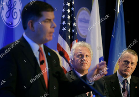 Marty Walsh, Jeff Immelt, Charlie Baker Boston Mayor Marty Walsh, left, speaks during a news conference as General Electric CEO Jeff Immelt, center, and Massachusetts Gov. Charlie Baker, right, look on in Boston, . The news conference was held to unveil more details about GE's move to the city. GE is pledging to spend $50 million on a series of initiatives in Boston