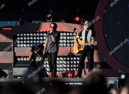 Yusef Islam, Cat Stevens, Eddie Vedder Eddie Vedder, left, and Yusef Islam, formerly Cat Stevens perform the song, Father and Son at the Global Citizen Festival in New York