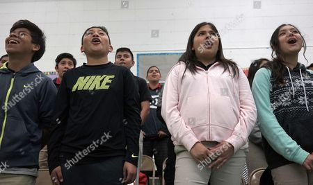 """This photo, students Landon Palacios, from left, Diego Castillo, Karen Nicifori and Jennifer Munoz sing during a music class at Stevenson Middle School in East Los Angeles. Los Angeles Unified School District, the nation's second largest, once had a $76.8 million budget for arts education, but years of cuts and layoffs wiped all arts classes from dozens of schools - leaving many students in the entertainment capital of the world with no music, visual arts, dance or theater instruction. That is slowly starting to change: The district is trying to enlist Hollywood studios to """"adopt"""" LA Unified schools and provide them with equipment, mentorships and training"""