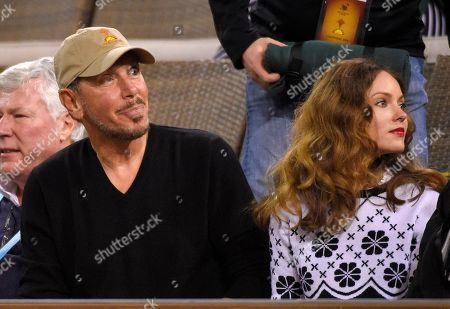 Larry Ellison, Nikita Kahn Larry Ellison, chief technology officer of Oracle, sits with actress Nikita Kahn as they watch Serena Williams play Laura Siegemund, of Germany, at the BNP Paribas Open tennis tournament, in Indian Wells, Calif