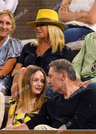 Suzanne Somers, Larry Ellison, Nikita Kahn Larry Ellison, right, chief technology officer of Oracle, sits with actress Nikita Kahn during a match between Novak Djokovic, of Serbia, and Philipp Kohlschreiber, of Germany, as actress Suzanne Somers, top, sits near them at the BNP Paribas Open tennis tournament, in Indian Wells, Calif